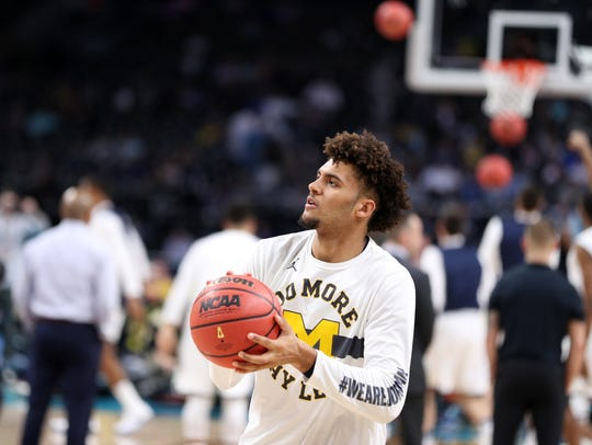 Michigan forward Isaiah Livers warms up before the