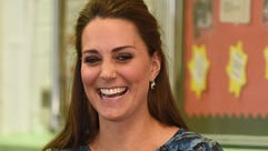 Duchess Kate smiles during an official engagement on