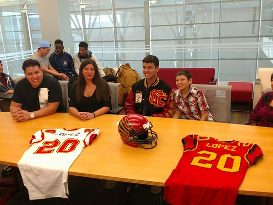 Centennial quarterback Dante Lopez signed with Western New Mexico during National Signing Day on Wednesday.