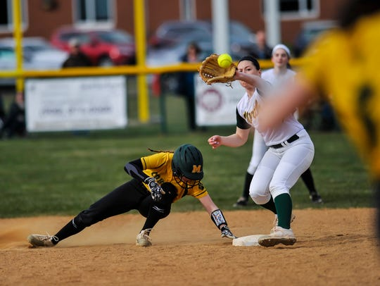 Kylie Karsay of Montgomery dives back to second base