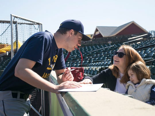 Pitcher Eric Thomas, talks with Heather Lehman, of Dallastown, and her daughter Harper Allison, 2, during York Revolution Fan Fest Saturday, April 16, 2016. Amanda J. Cain photo