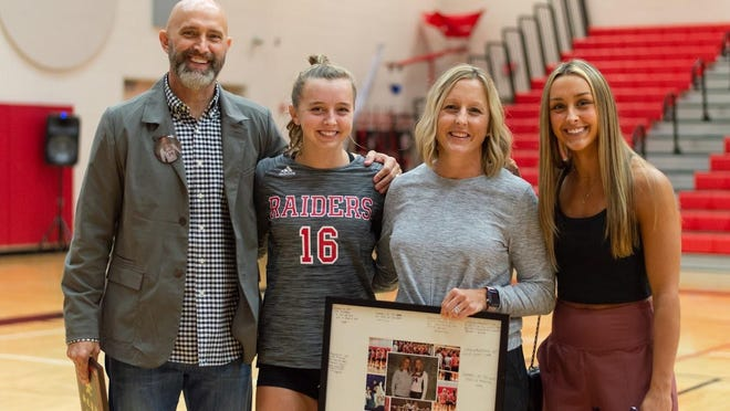 Savannah Christian volleyball coach Julie Jones, pictured second from right with her husband Jeff, and daughters Logan (No. 16, second from left) and Landon.