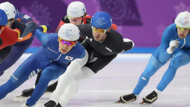 American Joey Mantia (black suit) skates in the men's mass start final Saturday.