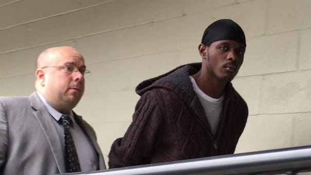 Charles McDonald arriving at the Hamilton Police Department following his arrest on Wednesday.