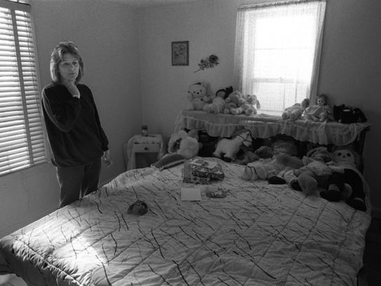 In this 1994 file photo, Rose Markey looks over her