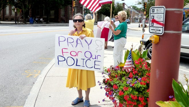 "Jack Ditzler of Hanover submitted this photo to the Evening Sun News and Community gallery Aug. 8. Ditzler writes, ""This afternoon these ladies stood on the square of Hanover with these signs in support of our police officers. It was hot and humid, but they stood there doing this. You should have heard the horns blowing in support of the police. God Bless these ladies and our police."""