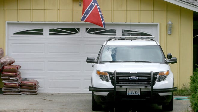 This photo shows a Confederate flag flying at the Silverdale home of Washington State Patrol Trooper James Manning on June 1. The flag has since been removed.