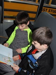 Weston Elementary School students read together as they participate in the Books on the Bus program.