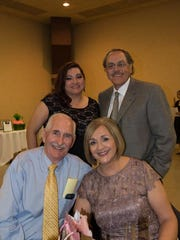 Back: Adriana Rodriguez, left, and David Flores. Front: Jim Brod, left, and Carmen Perez