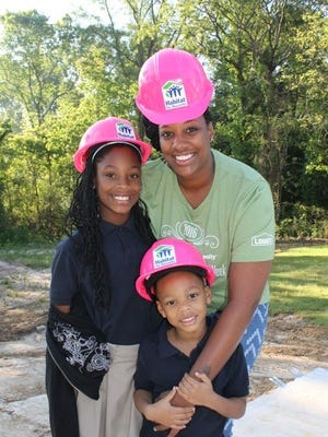 Habitat for Humanity Mississippi Capital Area's Women Build homeowner Natasha Thomas and children Janiya and Jayden don pink hardhats to greet volunteers Saturday. Thomas then worked alongside volunteers on her new home on Greenview Drive.   Women Build homeowner Natasha Thomas and her children Janiya and Jayden donned pink Women Build hardhats when they greeted volunteers today. Natasha then worked alongside volunteers on her new home.    Women Build homeowner Natasha Thomas and her children Janiya and Jayden donned pink Women Build hardhats when they greeted volunteers today. Natasha then worked alongside volunteers on her new home.  Women Build homeowner Natasha Thomas and her children Janiya and Jayden donned pink Women Build hardhats when they greeted volunteers today. Natasha then worked alongside volunteers on her new home.