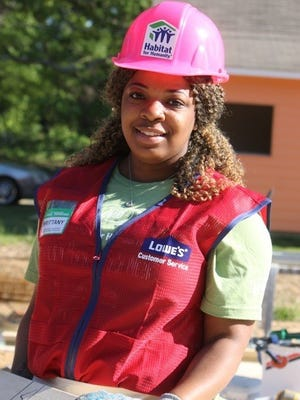 """A volunteer Brittany Catchings assists at a Habitat for Humanity build.Habitat for Humanity earned the distinction of being named the """"Most Loved"""" and """"Most Trusted"""" brand within its category this year, according to 2016 Harris Poll EquiTrend Study."""