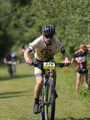 Pewaukee High School senior Nathan Warner works his way up a hill during a race at Minooka Park on Sunday, Sept. 10.