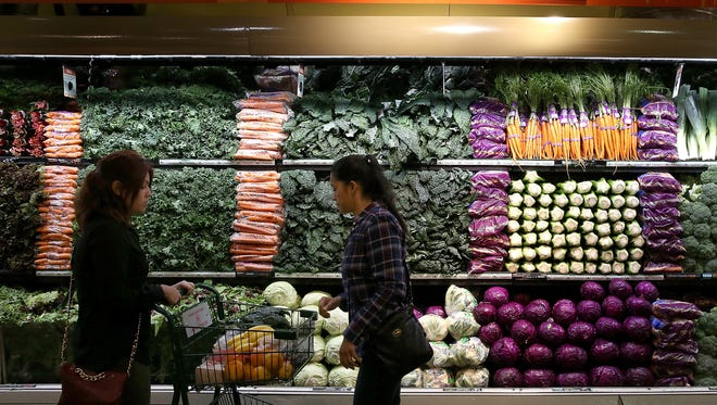 SAN FRANCISCO, CA - OCTOBER 15:  Customers shop for produce at a Whole Foods market on October 15, 2014 in San Francisco, California.