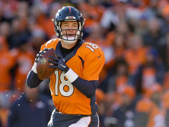 Denver Broncos quarterback Peyton Manning passes against