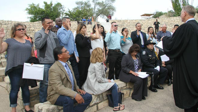 16 people from Kenya, Mexico and Iraq were sworn in as U.S. citizens at the Carlsbad Caverns National Park. The ceremony was part of the National Parks Service 100th anniversary.