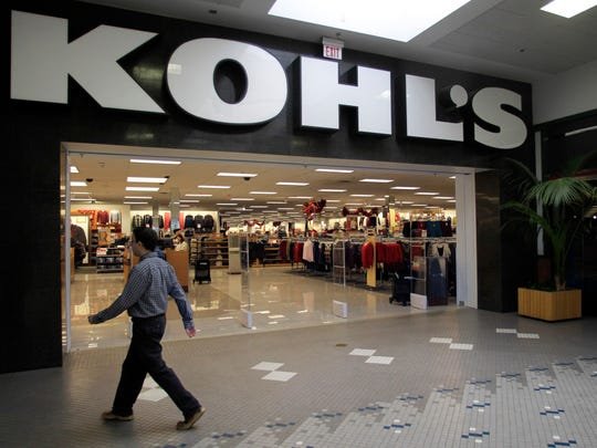 A passerby walks near the entrance of a Kohl's department