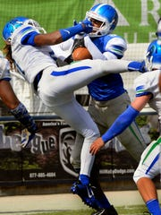 West Florida Blue Team wide receiver Kevin Grant goes into the end zone Saturday during the UWF football team's scrimmage at Blue Wahoos Stadium.