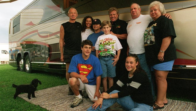 This 1999 photo shows Steve Kinser's life on the road, which included (back row, L to R) Owen Snyder, father-in-law of Steve Kinser, Dana Kinser, wife, Helen Whitehorse, mother-in-law, son Kurt, 11, Steve Kinser, Bob Kinser, father, Mayala Kinser, mother. In front, L to R - son Kraig, 14, and daughter Stevie, 15. The family travels the summer racing circuit together.