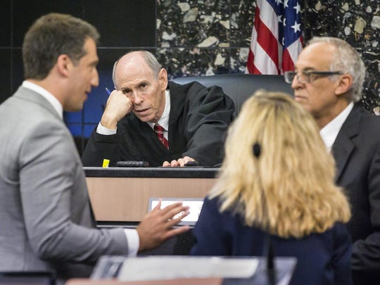 Judge Leonard Hanser holds a bench conference with attorneys during a motion hearing in the Robert Kraft's prostitution solicitation case in West Palm Beach Friday morning, April 26, 2019. Attorneys argue that undercover surveillance videos allegedly showing their client paying for sex at a Jupiter day spa should be ruled inadmissible and the evidence thrown out. At left is Alex Spiro, attorney for Robert Kraft, and at right are Assistant State Attorneys Judith Arco and Greg Kridos.