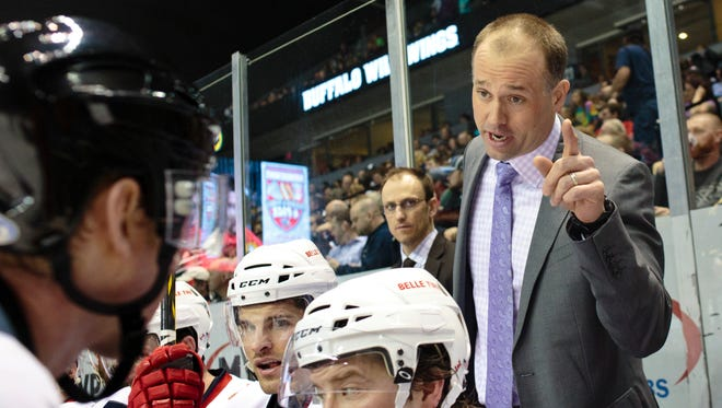In this Jan. 31, 2015 photo, Griffins head coach Jeff Blashill talks to the referee about a call that went in favor of the Milwaukee Admirals during the third period of an AHL hockey game at Van Andel Arena, in Grand Rapids, Mich.