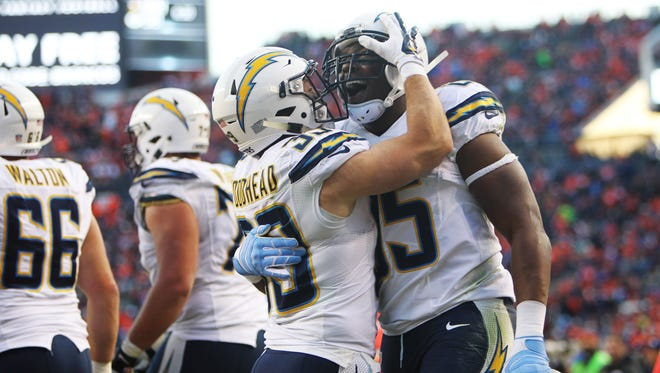 San Diego Chargers tight end Antonio Gates (85) celebrates with running back Danny Woodhead (39) after scoring a touchdown during the second half at Sports Authority Field at Mile High.