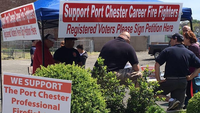 The paid Port Chester firefighters who lost their jobs set up a command post at 345 Westchester Ave. in May to gather support.