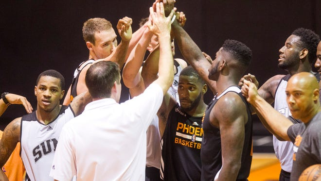 Suns head coach Jeff Hornacek (back turned) huddles up with prospective NBA draftees during a workout for prospective draftees at the practice court at the US Airways Center in Phoenix on Tuesday, May 27, 2014.