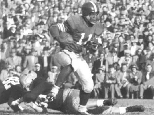 Jim Ellis rushes the ball against Notre Dame in 1951.