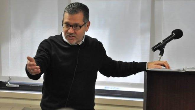 The Rev. Michael Calabria will speak at Madonna University.