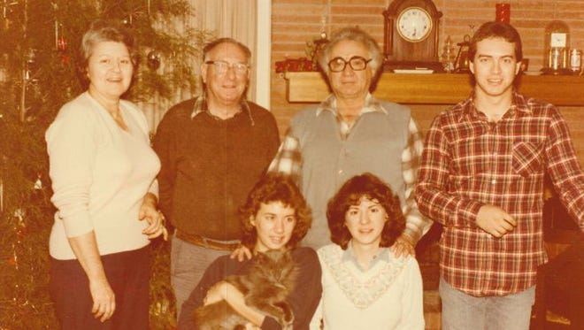 Isadore Rozeman, second from left, is shown in this family photo taken about a year before he was killed in 1983. Also pictured are Marcia Rozeman, back row, from left; Isadore Rozeman; Abe Rozeman (brother); Paul Rozeman (a son of Abe Rozeman); kneeling in front are Dena Rozeman (now Dena Martindale), left, and Sonya Rozeman (now Sonya Smith).