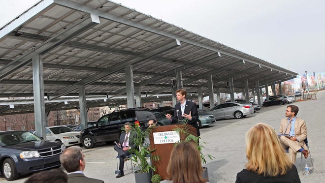 DNREC Secretary Collin O'Mara speaks at a press conference Friday announcing Wilmington has been ranked third in top U.S. cities for solar energy per capita. Delaware Technical and Community College used its new solar carport to showcase some of the solar technology used in Wilmington.