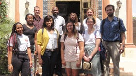 Centenary College students and faculty members stand with Mario Joseph after their meeting in Haiti.