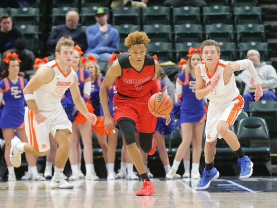 New Albany guard Romeo Langford (1) charges up the