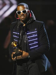 2008 winner for Best Rap Album Kanye West accepts the trophy at the 50th Grammy Awards in Los Angeles on February 10, 2008. West won Grammys for Best Rap Solo Performance and Best Rap Album.