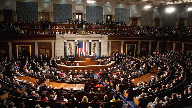 President Obama addressing Congress. All of those people, not listening.