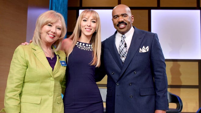From left to right, Renee Roberts, Ciara Roberts, Steve Harvey.