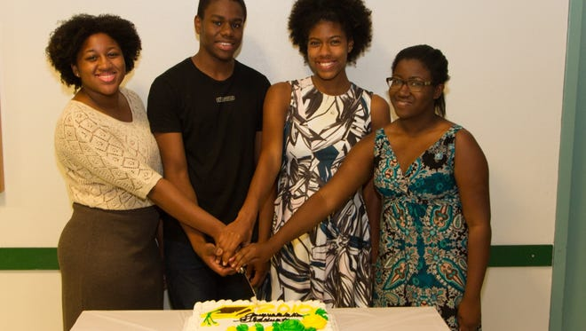 Four of the six JAMCCAR 2015 Scholarship Awardees. Pictured L-R:  Djion Holness, Noah Grannum, Kayla Tavares and Briana Turner