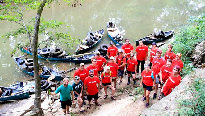 Nissan Employees team with Harpeth River Watershed Association on a Harpeth River cleanup in Franklin, Tenn. on Aug. 14, 2015