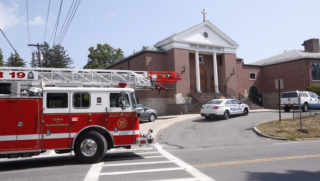 The Mamaroneck Fire Department wraps up operations after responding to a electrical fire at the Saints John & Paul School on Weaver Street in Mamaroneck on Sept. 9, 2015, the first day of school. The students were sent home early.