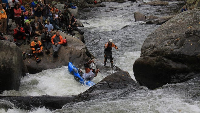 Spectators watch a kayaker compete in the Green River Narrows Race near Saluda. Recreational users, such as kayakers and hikers, are on the rise on the Green River Game Lands.