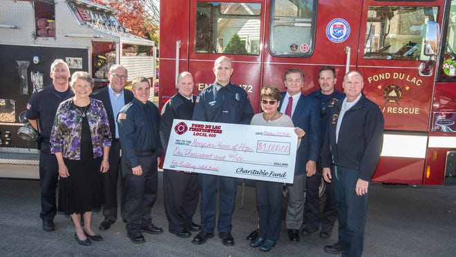 The Fond du Lac Firefighters Local 400 Charitable Fund (IAFF) has stepped forward as the first organizational donor to help support the Agnesian HealthCare Foundation's efforts to raise $2.5 million to add more private patient rooms at the Hospice Home of Hope residential facility, located at 400 County Road K in Fond du Lac (near St. Mary's Springs Academy High School). They recently joined Agnesian HealthCare Foundation representatives to make the donation, including (left to right): John Goldapske, lieutenant; Sister Mary Noel Brown, CSA, Foundation Board; Mike Shannon, Foundation Board; Sean White, firefighter/paramedic; Peter O'Leary, fire/rescue chief; Andy Aird, firefighter/paramedic; Rita Meidam, Foundation executive director; Jack Twohig, Foundation Board chairperson; Scott Ketelhut, engineer; and Troy Haase, division chief.