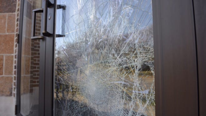 A panel of the front doors at Holy Myrrh Bearers Greek Orthodox Church is shattered Sunday after vandalism there.