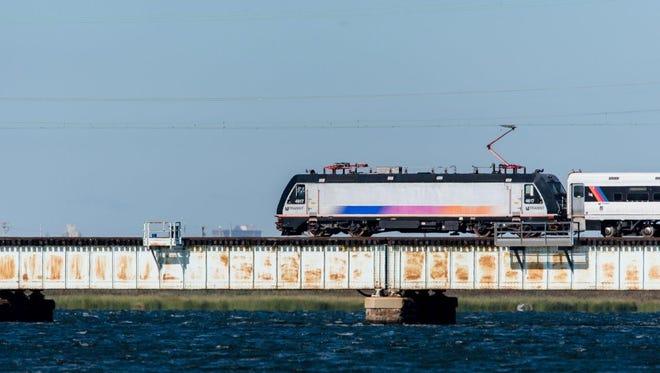 A train along NJ Transit's North Jersey Coast Line crosses the Raritan River Drawbridge.