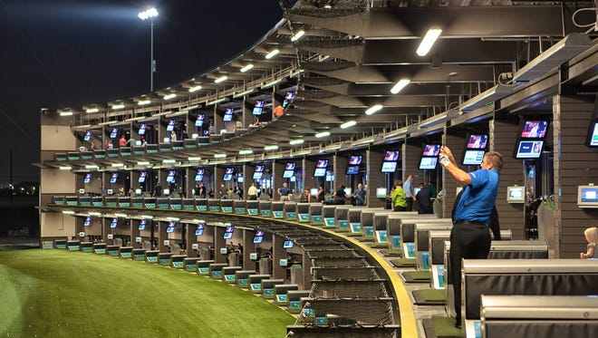 Tiered tee boxes and pavilions at Topgolf.