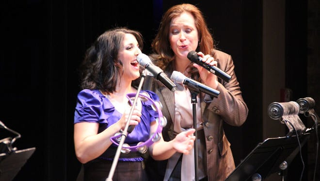 Lisa Rock, right, and back-up singer Amy Malouf singing all the Karen Carpenter memories.