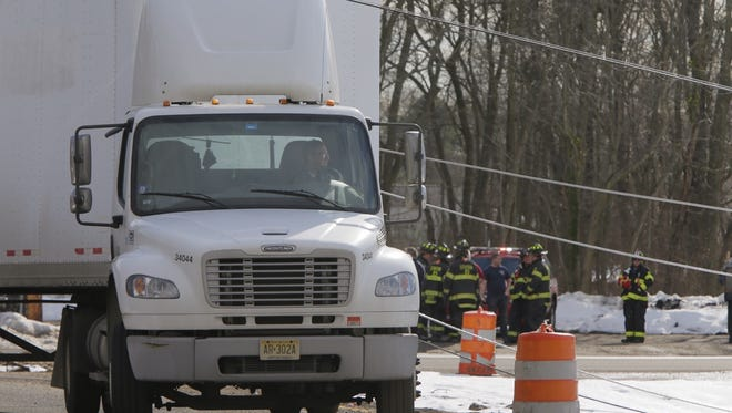 Driver trapped in truck that took down wires on Burrsville Road in Brick. Power is out in the area.