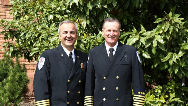 Newly sworn-in Washington City Fire Chief Matt Evans, left, is stepping in for the retired Brent Hafen, right, to lead the city fire department.