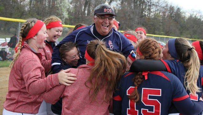 """Brookdale softball coach Thomas """"Bo"""" Scannapieco celebrates his 1,000th career win with his players."""
