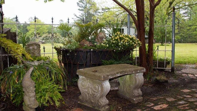 Sit a spell in the Wayne and Brenda Perryman yard while on the Trails & Trellis Garden tour.