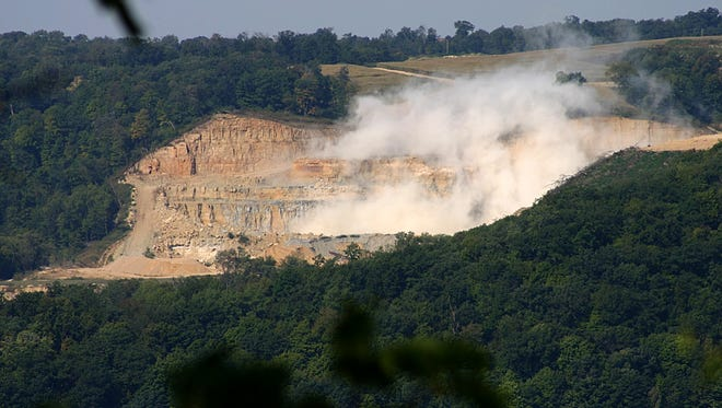 A blasting operation at Pattison Sand Co.'s surface mine in Iowa is seen on Sept. 14, 2015, from across the Mississippi River in Bagley, Wis. Homeowners Jim and Kathy Kachel say dust from the mine has gotten inside of their home.